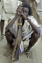 Portrait of ethiopian man with kalashnikov ethiopia closeup an afar ethnic population semi nomads livestock pastoralists from Stock Images