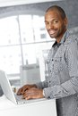 Portrait of ethnic office worker with laptop Royalty Free Stock Photos
