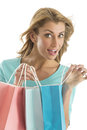 Portrait of excited woman carrying shopping bags young isolated over white background Royalty Free Stock Image