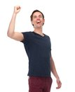 Portrait of a excited young man with arm raised up isolated on white background Stock Photo