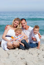 Portrait f a cheerful family holding suncreen Stock Photo