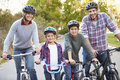 Portrait of family on cycle ride in countryside smiling Royalty Free Stock Photos