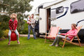 Portrait of family enjoying camping holiday in camper van smiling Stock Image