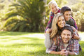 Portrait Of Family Lying On Grass In Countryside Royalty Free Stock Photo