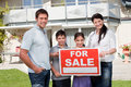Portrait of family selling their house Royalty Free Stock Photo