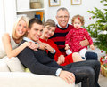 Portrait of a family sitting together at christmas Royalty Free Stock Images
