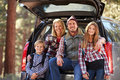 Portrait of family by their car before hiking, California Royalty Free Stock Photo