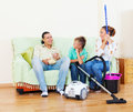 Portrait of family of three finished housework ordinary in home Stock Photos
