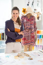 Portrait of fashion designer in front of mannequin Royalty Free Stock Photo
