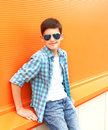 Portrait fashion smiling child boy wearing a sunglasses and shirt Royalty Free Stock Photo