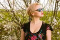 Portrait of fashionable blonde woman posing wearing shades Royalty Free Stock Photo