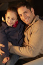 Portrait father and daughter by firelight Royalty Free Stock Photo