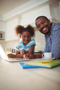 Portrait of father and daughter with laptop Royalty Free Stock Photo
