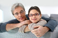 Portrait of father and his daughter on sofa Royalty Free Stock Photo