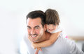 Portrait of father with his little girl on his back Royalty Free Stock Photo