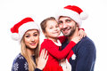 Portrait of father, mother and daugher on Christmas holiday Royalty Free Stock Photo