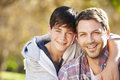 Portrait Of Father And Son In Countryside Royalty Free Stock Photo