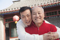 Portrait of father and son outside traditional Chinese building Royalty Free Stock Photo