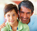 Portrait of a father and son smiling together Royalty Free Stock Photo