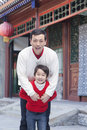 Portrait of father and son by a tradition chinese building Royalty Free Stock Photos
