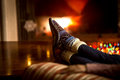 Portrait of feet at woolen socks warming at fireplace in winter Royalty Free Stock Photo
