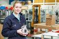 Portrait Of Female Apprentice Holding Component