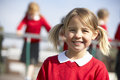 Portrait of female elementary school pupil in playground Royalty Free Stock Photo