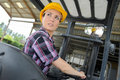 Portrait female fork lift truck driver in warehouse Royalty Free Stock Photo