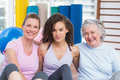 Portrait of female friends sitting in gym Royalty Free Stock Photo