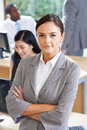 Portrait Of Female Manager In Busy Office Royalty Free Stock Photo