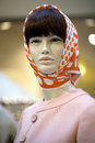 Portrait of female mannequin in orange scarf Royalty Free Stock Photo