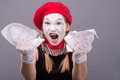 Portrait of female mime angry crumpling a paper Royalty Free Stock Photo