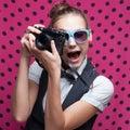 Portrait of female photographer expressive Royalty Free Stock Photos