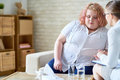 Obese Young Woman Talking to  Psychiatrist Royalty Free Stock Photo