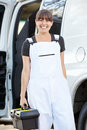 Portrait of female repair person with van smiling to camera Stock Photo