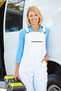 Portrait of female repair person with van smiling to camera Royalty Free Stock Photo