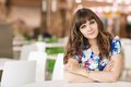Portrait of a female shopper sitting at cafe table Royalty Free Stock Photos