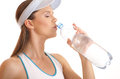 Portrait of a female tennis player drinking water Royalty Free Stock Photo