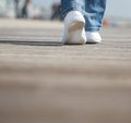 Portrait of a female walking in comfortable white shoes close up Royalty Free Stock Photos