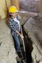 Portrait of female worker digging with shovel at construction site Stock Photos