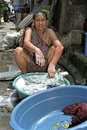 Portrait of filipino woman city manila philippines capital or manilla slum malate this washerwoman laundress sits with colorful Royalty Free Stock Photo