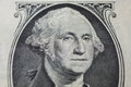 Portrait of the first president of the United States, the US founding father George Washington on the one dollar bill Royalty Free Stock Photo