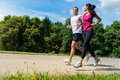 Portrait of fit couple running outdoors caucasian Royalty Free Stock Photo