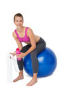 Portrait of a fit woman sitting on exercise ball Royalty Free Stock Photo