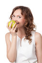 Portrait of fit young girl biting a fresh ripe apple Royalty Free Stock Images