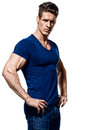 Portrait of a fitness man in blue shirt and jeans Royalty Free Stock Photo