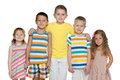 Portrait of five cheerful children joyful are standing on the white background Stock Images