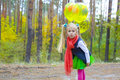Portrait of five year old girl with balloons amusing playing in the wood Stock Images