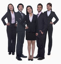 Portrait of five young smiling businesswomen and young businessmen looking at camera studio shot Stock Image