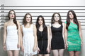 Portrait of five young women in a police lineup Royalty Free Stock Photo
